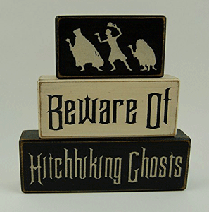 """Stacking blocks that say, """"Beware of Hitchhiking Ghosts,"""" and have three ghosts trying to hitch a ride."""