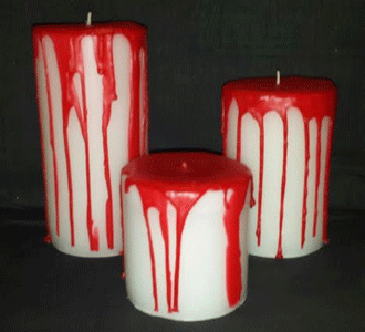 Three large pillar candles that appear to be bleeding