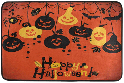 This cute Halloween rug has smiling pumpkins and says,