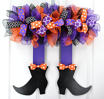 This handmade wreath looks like a witch's skirt, legs, and feet, and would be perfect for Halloween!