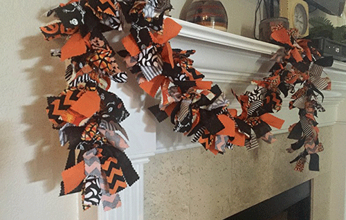 This handmade black, orange, and white garland is perfect for Halloween decorating on a fireplace mantel, bannister, or over a window or door!