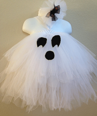 This adorable handmade dress has a ghost's face on the skirt.